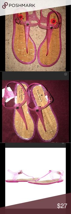 "NEW KATE SPADE Jelly glitter sandal flipflops yari BRAND NEW with TJMAXX tags (no box) Kate Spade New York  ""Yari"" t-strap sandals Women's size 6 Pink jelly with glitter accents  Gold-toned buckles and spade logo on strap Lightly padded Cork footbed Retails for $68 kate spade Shoes Sandals"