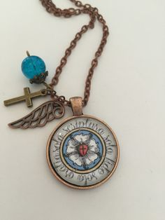 """Beautiful handcrafted glass pendant necklace with Martin Luther's Seal surrounded by the Latin inscription """"Sola fide, sola gratia, sola scriptura"""" which means """"Faith alone, grace alone, scripture (wo"""