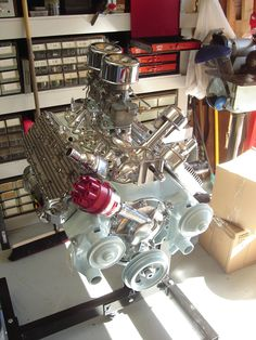 A photo of the completed '51 Mercury Flathead engine that was in the Massachusetts Venus. The distributor is an electronic ignition unit from Mallory; cap will be replaced with black. Top air filters will not fit under hood, so will run with screens and foam inserts only. Period-correct Offenhauser heads and Offy dual intake manifold; correct and restored Stromberg 97 carburetors with fuel rail and pressure gage. Engine color will probably change after all is said and done.