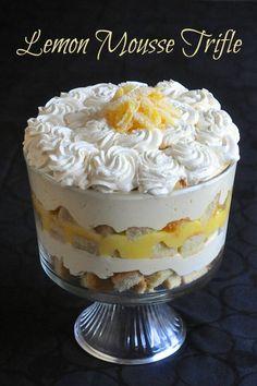 Lemon Mousse Trifle - a lemon lovers dream & Easter dessert favourite! - - Lemon Mousse Trifle - a lemon lovers dream! It's a simple but delicious combination of sponge cake, lemon mousse, limoncello liqueur and whipped cream. Trifle Bowl Desserts, Trifle Cake, Trifle Recipe, Lemon Desserts, Lemon Recipes, Easy Desserts, Sweet Recipes, Dessert Recipes, Tiramisu Trifle