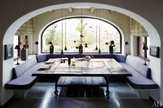 On a pastoral estate in Italy, aristocratic architect Benedikt Bolza transforms a centuries-old house into a grand, rustic dwelling. The dining room's banquette and square oak table were custom made.