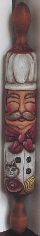 rolling pin I carved for Lynn Snyder, I carved it and she painted it.