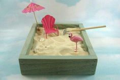 Miniature flamingo, chair, umbrella