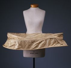 Panniers, or hoops, widely worn in the eighteenth century, first came into fashion around 1710, giving a dome-shaped structure to the skirt. The fan-shaped hoops gradually became flatter and more horizontal in emphasis, resulting in oblong hoops. This style grew to its largest proportions during the 1740s and 1750s, with incredibly cumbersome dresses being worn to formal occasions