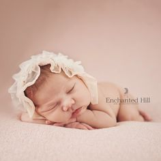 baby in pink hat
