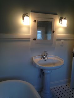 Vintage attic bathroom remodel, pedestal sink, built-in medicine cabinet and clawfoot tub.