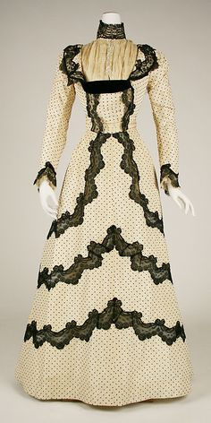 Dress, Afternoon. Beige with black polka dots, and black lace trim.  Date: 1897–98 Culture: American or European Medium: silk  Metropolitan Museum of Art  Accession Number: 1974.308.4a, b