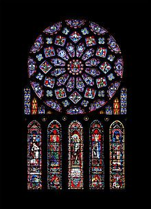 """Here is the north rose window in the Chartres Cathedral which is dedicated to the Virgin mad in (c.1235). This is the prime example of the Gothic """"Rayonnant"""" style; which consisted of large colorful circular windows that would tell different stories.  As a side note even if someone was not paying attention during mass by just looking at the windows they would still be learning a lesson in history."""