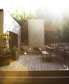 Home - Outdoor Rooms - modern wood deck, lounge chairs and outdoor fireplace