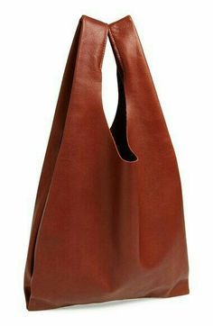 fa4f49217755 A minimalist carryall made from natural milled leather is a lightweight  grab-and-go crafted in New York City.  li   li By Baggu®