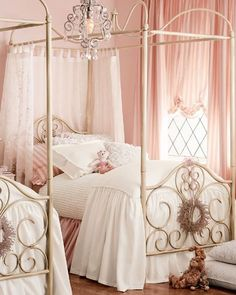 Curtains around the head of bed, cute wreath and darling chandelier! We'd spend HOURS watching Once Upon a Time, drinking tea, and laughing, laughing, laughing!