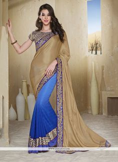 Be an angel and create and ascertain a smashing effect on every single person by carrying this blue faux chiffon designer saree. The brilliant attire creates a dramatic canvas with remarkable embroide...