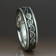 This band pairs nicely with the next wedding ring set--both sterling silver/oxidized with leaf embelishments.