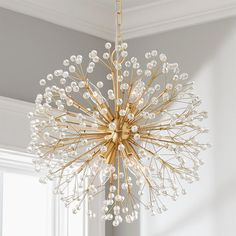 This sparkling chandelier merges glamour and whimsy with crystal bedazzled stems branching into a glittering globe reminiscent of evanescent dandelion seed heads, iridescent snowflakes, and twinkling stars all at once. Wood Chandelier, Modern Crystal Chandelier, Modern Chandelier, Closet Chandelier, Dandelion Light, Candle Base, Chandelier In Living Room, Chandelier, Ceiling Lights