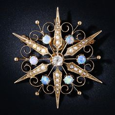 Antique Opal and Diamond Starburst  Brooch. This lovely British made Victorian starburst pin glistens three ways: The central old mine-cut diamond is orbited by six extremely colorful opals, and the six-legged star shimmers with tiny natural pearls. A celestial beauty from the late 1800s.