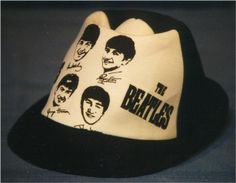 You could mail in to buy a Beatle beach hat in 1964 - they came in deep blue/white and red/white. Several of the kids I went to the first Beatle concert in '64 had these - I had a Beatle fake leather cap instead.