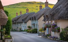 Lulworth, Dorset, England A beautiful row of cottages greets each visitor heading down this hill towards Lulworth Cove. Not a bad introduction to a beautiful village along the Jurassic Coast of southern England English Country Cottages, English Village, English Countryside, English Farmhouse, Country Homes, England And Scotland, England Uk, Dorset England, Beautiful World