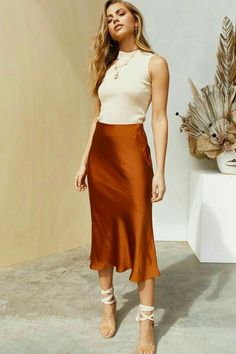 Silky midi skirt in rust Matte look satin Concealed zip at side High-waisted fit Polyester Model wears size 6 and is tall Model stats: Bust Waist Hips Classy Outfits, Chic Outfits, Vintage Outfits, Fashion Outfits, Blue Skirt Outfits, Midi Skirt Outfit, Slip On Dress Outfit, Dress Vintage, Vintage Prom