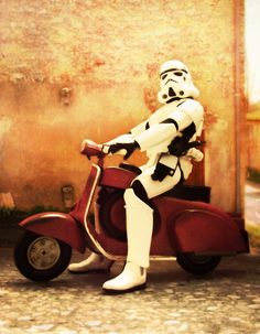 StormTrooper on a scooter... THERE'S something you don't see everyday! (At least, not here, on EARTH!)