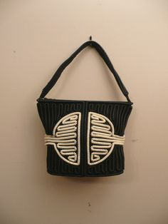 Drool....i just had to make this purchase.....Vintage 1940s Handbag Telephone Cord Purse
