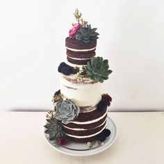 Naked and semi-naked wedding cake with succulents, fresh blackberries and flowers by Blossom & Crumb