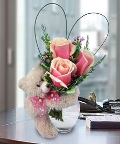 A cuddly teddy bear and a vase filled with 3 pink roses, a perfect gift from the heart.  Love it? We ship nationwide! @marcoflorist