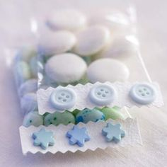 Pretty Party Favors  -  Fill small cellophane bags with candy or mints. Use decorative-edge scissors on both the top and bottom edge of a strip of card stock, adhere to the top of the cellophane bag. Glue on leftover decorative buttons or other scrapbook embellishments.