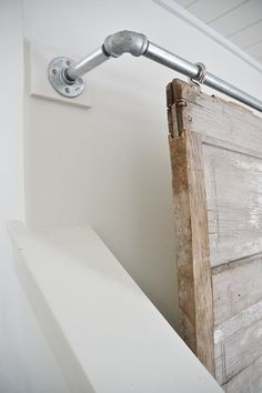 THE BEST WAY TO HIDE THOSE TV'S! A super simple industrial pipe sliding barn door television cover. A great way to decorate around those TV's in any room in your home. See full tutorial on the Industrial Decor, Home Projects, Remodel, Tv Covers, Barn, Diy Barn Door, Diy Door, Home Diy, Doors