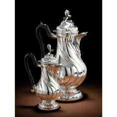 A DUTCH SILVER COFFEE SERVICE COMPRISING SPIRALLY FLUTED COFFEE POT AND HOT MILK JUG, JOHANNES NICOLAUS GILISSEN, MAASTRICHT, 1776-1778