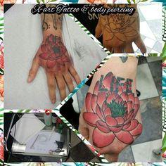 flower fist tattoo