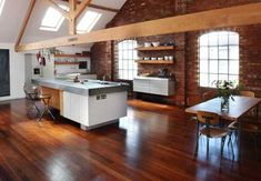 Love the unique, open feel to this and also the exposed brick