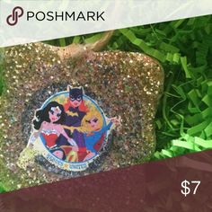 DC Comics Female Super Heroes glitter Ornament This great ornament is hand decoupaged  in Baltimore..This is a unique piece each one I make has completely different mixes of glitter, paint, and color! A complimentary gift bag will be provided with your package! :-) ****save 20% on your order by ordering more than one item from my closet 🎄🎄🎄 Sassy Brands Accessories