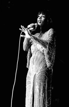 1976: Donna Summer drips elegance in a beaded gown with thigh-high split.