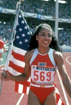 """I wish that I could run like Flo Jo. Never could, so I wrote a poem, """"Run Like Flo Jo"""", instead. It was horrible to find out on my birthday in 1998 that Flo Jo died unexpectedly the day before. Flo Jo, Famous People With Epilepsy, List Of Famous People, Indiana Pacers, Florence Griffith Joyner, Black History Month Facts, History Facts, 1988 Olympics, Korea Olympics"""
