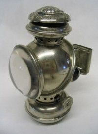 The UNIQUE Bicycle Lamp, nickel plated,  by The Manhattan Brass Company.  J.M. Herman's #578,564 - Mar. 9, 1897  And D29,535, October 25, 1898.  Photo courtesy of Copake Auction Inc.
