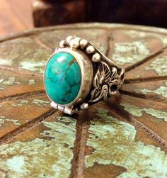 Our sterling silver turquoise dragon poison ring is classic in Tibetan design. Rings like this have been used throughout history to carry perfume, poison, locks of hair, devotional relics, messages an