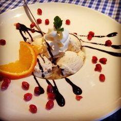 Ice cream from maple syrup with balsamic vinegar with fruits of the forest