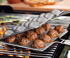 This Outdoor BBQ Meatball Grilling Basket by Outset can holds up to 12 meatballs and locks them securely is place! It's easy to clean its non-stick coating. YUMMY!