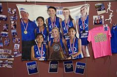 Our State wall of fame. That's a 40x60 plush blanket done at walmart. Around $60. This team were the State runners-up!!!! Very proud :)