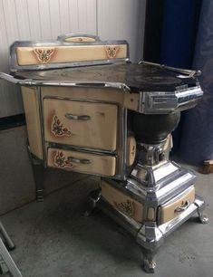 Victorian House Like This Page · 15 hrs · An Unusual Art Nouveau Cast Nickel & Porcelain Stove, from France (Circa Unusual Furniture, Victorian Furniture, Vintage Furniture, Cool Furniture, Antique Kitchen Stoves, Antique Wood Stove, How To Antique Wood, Cuisinières Vintage, Vintage Decor
