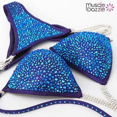 This blue crystal competition bikini shines with perfectly scattered sapphire blue AB crystals on a deep purple fabric. Beautiful simplicity.  And don't forget to check out our full range of figure suits & competition bikinis at >> www.muscledazzle.com