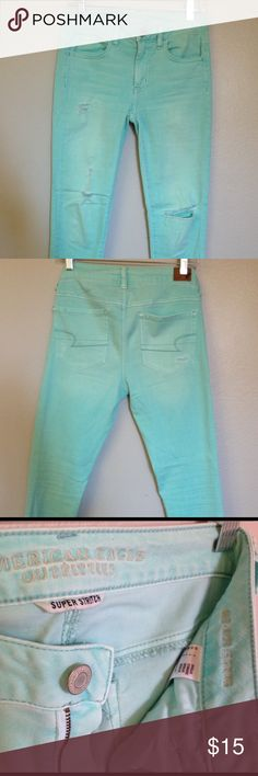 """American Eagle Aqua Distressed Mid-Rise Jegging American Eagle distressed mid-rise super stretch jeggings in fun Aqua color. Large distressing on left knee about 4"""" wide, small distressing on right leg, and back pockets. 9"""" rise, 28"""" inseam, 10"""" leg opening. 69% cotton, 21% polyester, 9% viscose, 1% elastane. Worn twice, perfect condition! American Eagle Outfitters Jeans Skinny"""