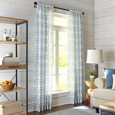 If you're ready for a fresh look, but you want to keep it bold, look no further. The woven linen-like teal fabric gives these curtains a sheer look—but with substance. A geometric pattern keeps things looking modern and rod-pocket construction makes for a speedy update.