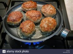 Download this stock image: On fire gas stove in the pan fried delicious patties. Presents closeup. - KRR82K from Alamy's library of millions of high resolution stock photos, illustrations and vectors.