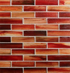 Tozen 1x4 Brick in Marrakech Red Natural. Glass Tile by Stone & Pewter Accents