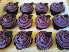 pretty gothic rose cupcakes - purple and black, but I think I would make the black leaves little bats instead.