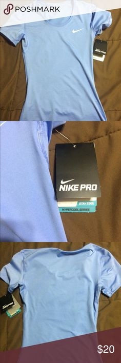 Nike pro shirt! This shirt is super soft and silky! I love it it's just too tight for me! Nike Tops Tees - Short Sleeve