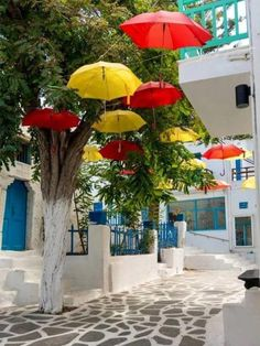 Colorful street in Naxos, Cyclades, Greece Beautiful Islands, Beautiful World, Wonderful Places, Beautiful Places, Naxos Greece, Myconos, Parasols, Umbrellas, Beaux Villages