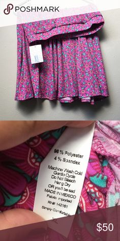 NWT LuLaRoe Madison Skirt New with tags LuLaRoe Madison skirt. The Madison skirt is full skirted and features hand-set box pleats and hidden pockets. This skirt features a fresh, bright pattern and will be perfect for dressing up or down! LuLaRoe Skirts A-Line or Full