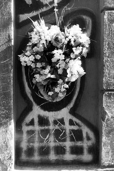 Flowers for a graffiti artist.
